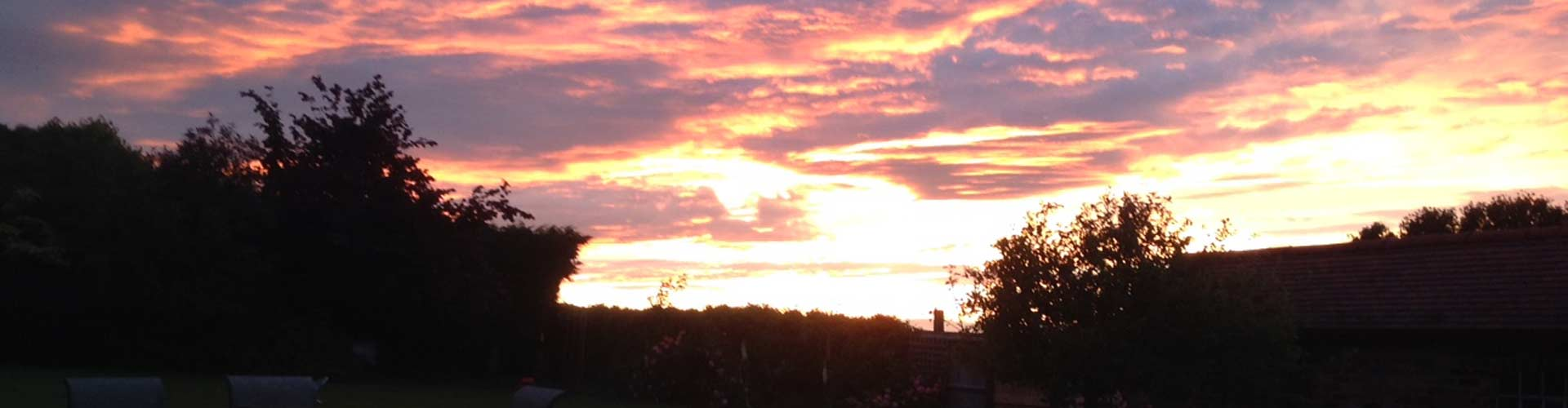 Sunset over New Wood Farm Barn and Stable